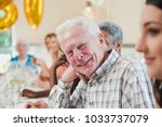 happy senior man at a birthday... | Shutterstock . vector #1033737079