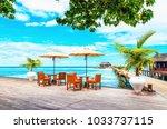 restaurant with sun umbrellas...   Shutterstock . vector #1033737115