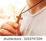 the wooden cross necklace on... | Shutterstock . vector #1033747204