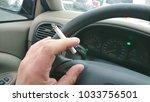 a man smoking in car while...