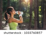girl drinking water from bottle ... | Shutterstock . vector #1033760857