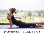 asian woman exercise yoga pose... | Shutterstock . vector #1033764715