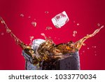 Ice Cubes Splashing Into Cola...