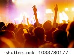 crowd of concert stage lights... | Shutterstock . vector #1033780177