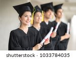 graduation day  row of happily... | Shutterstock . vector #1033784035