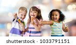 happy kids group eating ice... | Shutterstock . vector #1033791151
