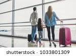 family in airport. attractive... | Shutterstock . vector #1033801309