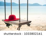 Wooden Swing With A Hat On...
