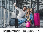 Small photo of Family in airport. Attractive young woman, handsome man and their cute little daughter are ready for traveling! Happy family concept.