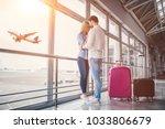 romantic couple in airport.... | Shutterstock . vector #1033806679