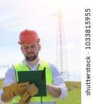 an electrician in the fields... | Shutterstock . vector #1033815955