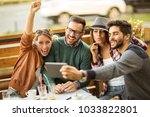group of four friends having a... | Shutterstock . vector #1033822801