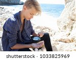 young teenager male holding... | Shutterstock . vector #1033825969