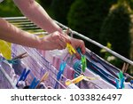 woman hang washed laundry... | Shutterstock . vector #1033826497
