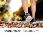 close up of feet of a runner... | Shutterstock . vector #103383074