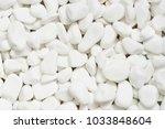 white stones  white background  ... | Shutterstock . vector #1033848604