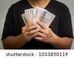 investments in thai baht   Shutterstock . vector #1033850119