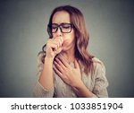 young woman having asthma... | Shutterstock . vector #1033851904