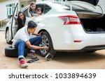 father change a new tire ... | Shutterstock . vector #1033894639