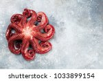raw octopus cooking on stone... | Shutterstock . vector #1033899154
