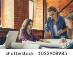 young business people at meeting | Shutterstock . vector #1033908985