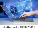 hand using laptop with database ... | Shutterstock . vector #1033925011
