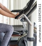 woman legs spinning on fitness... | Shutterstock . vector #1033925611