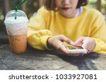 woman use of cellphone | Shutterstock . vector #1033927081