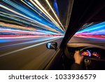 the car moves at high speed at... | Shutterstock . vector #1033936579