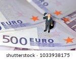 miniature man greets the euro... | Shutterstock . vector #1033938175