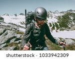 Small photo of Man adventurer with backpack climbing mountains expedition Travel survival lifestyle concept adventure outdoor active vacations