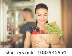young couple in the kitchen  ... | Shutterstock . vector #1033945954