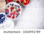 top view on oat flakes with... | Shutterstock . vector #1033951789