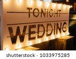 the illuminated inscription is...   Shutterstock . vector #1033975285