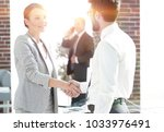 welcome and handshake business... | Shutterstock . vector #1033976491