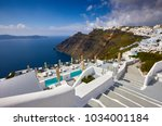 fira town on santorini island ... | Shutterstock . vector #1034001184