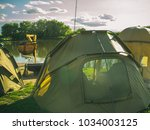 tent camp on river or lake... | Shutterstock . vector #1034003125