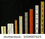 Small photo of Rulers and scales in metric and inches ascend along a chart or graph representing measurement, metrics, precision, increase, growth, accuracy and results with copy space.