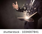 man holding a book with... | Shutterstock . vector #1034007841