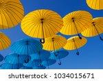 colorful umbrellas under the...   Shutterstock . vector #1034015671