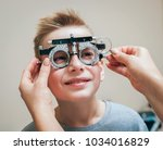 Small photo of Trial frame. Glasses for a little boy. Hypermetropia. Ametropia correction with glasses.