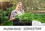 portrait of smiling woman...   Shutterstock . vector #1034017549