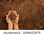 Soil In A Strong Farmer's  Man...