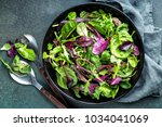 fresh salad mix of baby spinach ... | Shutterstock . vector #1034041069
