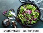 fresh salad mix of baby spinach ... | Shutterstock . vector #1034041081