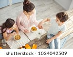 breakfast together. athletic... | Shutterstock . vector #1034042509