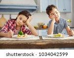 we hate vegetables. attractive... | Shutterstock . vector #1034042599