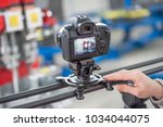 videographer using camera... | Shutterstock . vector #1034044075
