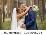 bride and groom embracing in... | Shutterstock . vector #1034046295