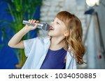 little beautiful child singing... | Shutterstock . vector #1034050885